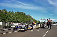 May 31, 2013; Englishtown, NJ, USA: NHRA crew members for top fuel dragster driver Khalid Albalooshi during qualifying for the Summer Nationals at Raceway Park. Mandatory Credit: Mark J. Rebilas-