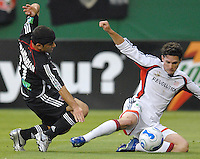 New England Revolution defender Jay Heaps fighting to keep control of the ball against DC United forward Alecko Eskandarian. DC United defeated the New England Revolution 1-0 at RFK Stadium, Washington DC, June 3, 2006.