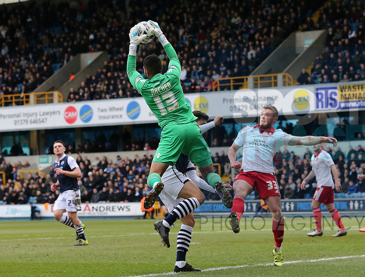 Millwall's Jordan Archer catches the ball from Sheffield United's Florent Cuvelier during the League One match at The Den.  Photo credit should read: David Klein/Sportimage