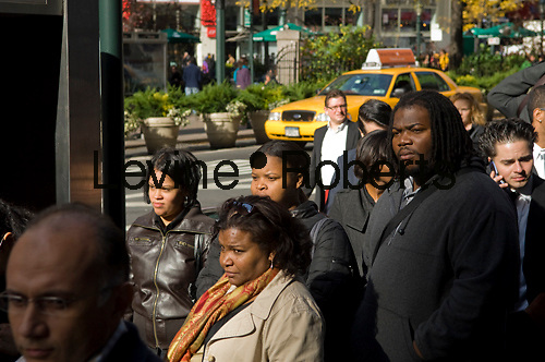Job seekers line up for a job fair in midtown in New York on Monday, November 16, 2009. Weakness in the labor  market persists.  (© Frances M. Roberts)