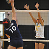 Wantagh No. 9 Haley Labo, right, defends against a spike attempt by South Side No. 10 Kate Keady during a Nassau County varsity girls' volleyball match at Wantagh High School on Friday, October 23, 2015. Wantagh won 25-15, 25-17, 28-26.<br /> <br /> James Escher