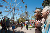 Occidental College kicked off a yearlong celebration of its 125th anniversary on Friday, April 20, 2012 with an 1887-style carnival in the Quad, complete with Ferris wheel.<br /> (Photo by Dennis Davis, Freelance for Occidental College)