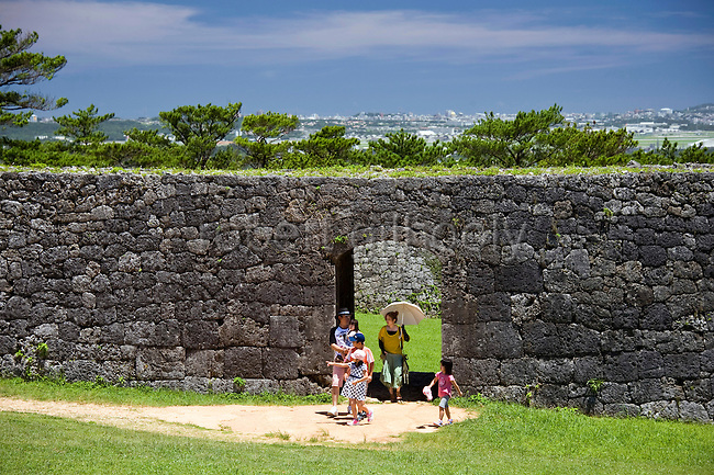 Visitors exit the gate leading to the main ward at Zakimi Castle ruins in Yomitan VILLAGE, Okinawa Prefecture, Japan, on May 20, 2012. Built between 1416 and 1422 by the renowned Ryukyuan militarist Gosamaru, Zakimi Castle oversaw the northern portion of the Okinawan mainland. Photographer: Robert Gilhooly