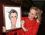 Marlee Matlin, posing with the Henry Winkler Sardi's portrait, attends the Marlee Matlin Sardi's Portrait unveiling at Sardi's Restaurant on November 24, 2015 in New York City.
