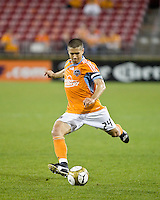 Houston Dynamo defender Wade Barrett (24) passes the ball  Houston Dynamo tied Atlante FC 1-1 at Robertson Stadium in Houston, TX on February 24, 2009 in CONCACAF Champions League play .  Photo by Wendy Larsen/isiphotos.com