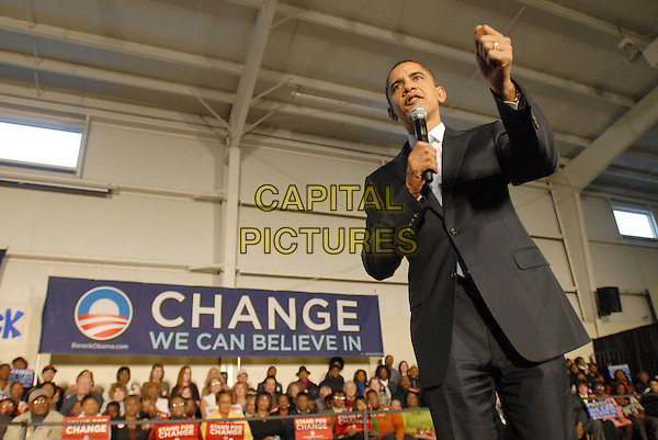 SENATOR BARACK OBAMA.Barack Obama's Presidential Campaign makes a stop at the Newton Family Life Center in Sumter, South Carolina, USA, 23 January 2008..half  length crowd speaking microphone hand change banner.CAP/ADM/MO.©Moose/AdMedia/Capital Pictures.