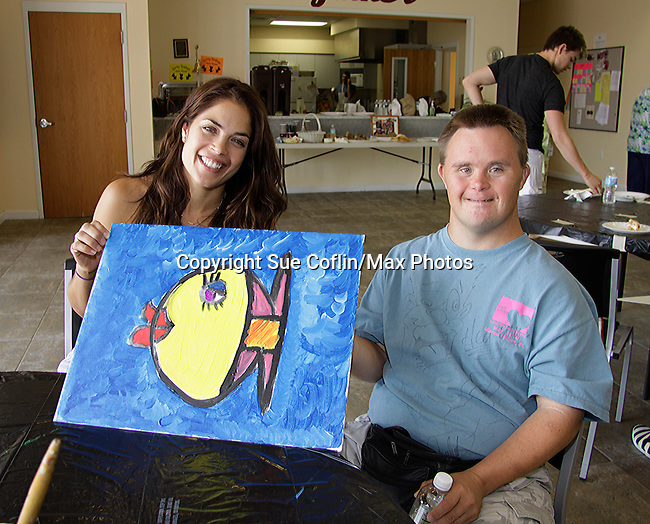 Kelly Thiebaud - General Hospital shows off lady fish she did with Frankie at 15th Soapfest 2014 painting party on May 24, 2104 gathered together to do paintings with guests and the proceeds went to charity - The weekend of events is held on Marco Island, Florida.  (Photo by Sue Coflin/Max Photos)