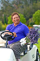 Alii Chang, agricultural artist, horticulturalist and owner of Alii Kula Lavender farm at the base of Haleakala, Kula, in his mini-cart with a bouquet of lavender flowers