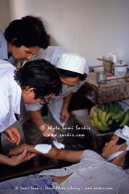 Wounded boy being treated by a nurse at Nam Dong hospital, Vietnam.