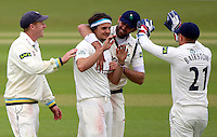 PICTURE BY VAUGHN RIDLEY/SWPIX.COM - Cricket - County Championship - Yorkshire v Derbyshire, Day 2 - Headingley, Leeds, England - 30/04/13 - Yorkshire's Jack Brooks celebrates with Liam Plunkett Andrew Gale and Jonny Bairstow after bowling Derbyshire's Tony Palladino.