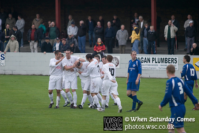 Linlithgow Rose 4 Pumpherston Juniors 0, 20/08/2008. Prestonfield Stadium, Dechmont Forklift League Cup. Players of Linlithgow Rose, dressed in their change strip of white, celebrating their opening goal against Pumpherston Juniors at Rose's Prestonfield ground in a Dechmont Forklift League Cup group match which the home side won 4-0. Junior football was divided into East, West and North sections and played throughout Scotland. It had its own governing body, the SJFA and regional pyramid structure and national cup competition. Photo by Colin McPherson.