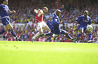Premiership Football - Arsenal v Leicester City:.2003/04 Season - 15/05/2004  [Record breaking Season undefeated].Fredrick Ljungberg attacs the Leicester goal.[Credit] Peter Spurrier Intersport Images