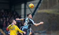 Matt Bloomfield of Wycombe Wanderers beats Liam Lawrence of Bristol Rovers   in the air during the Sky Bet League 2 match between Wycombe Wanderers and Bristol Rovers at Adams Park, High Wycombe, England on 27 February 2016. Photo by Andy Rowland.