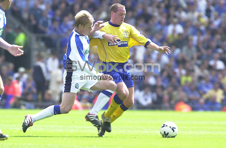 Pix: Simon Wilkinson/SWPIX. Pre Season Soccer. Blackburn v Everton..COPYWRIGHT PICTURE>>SIMON WILKINSON>>01943 436639>>..GAZZA.Paul Gascoigne leaps through the challenge of Blackburns Gary Flitcroft