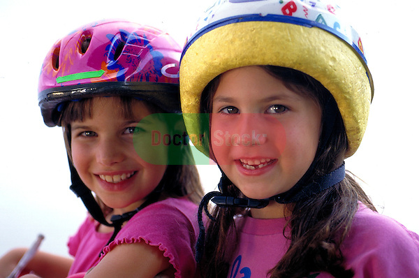 portrait of young girls wearing bicycles helmets
