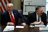 United States President Donald J. Trump and US Secretary of State Mike Pompeo laugh during a Cabinet Meeting at the White House in Washington, DC on October 21, 2019. <br /> Credit: Yuri Gripas / Pool via CNP