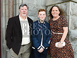 Ryan Grahame who was confirmed in St Mary's church pictured with mam Leanne and grandfather Eddie Grahame. Photo:Colin Bell/pressphotos.ie