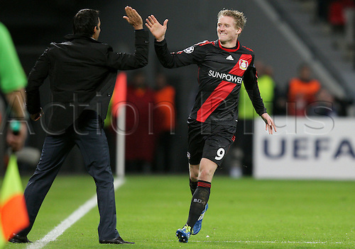 19.10.2011 Leverkusen, Germany.  Leverkusen's Andre Schuerrle (r) celebrates his goal with head coach Robin Dutt during the UEFA Champions League group E soccer match between Bayer Leverkusen and Valencia CF at BayArena Stadium in Leverkusen, Germany. Mandatory credit: ActionPlus