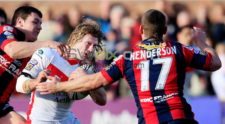 Pix: Chris Mangnall/SWpix.com, Rugby League, Super League. 02/03/08. St Helens v Wakefield Wildcats....picture copyright>>simon wilkinson>>07811267 706>>....St Helens's Sean Long  tackled by Wakefield's Brett Ferres and Kevin Henderson