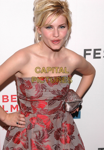 "ELISHA CUTHBERT.Premiere of his new film, ""House of Wax"", at the Stuyvesant High School,  part of the Tribeca Film Festival in downtown Manhattan. .April 30th, 2005.Photo Credit: Patti Ouderkirk/AdMedia.half length strapless red floral print dress hand on hip jewel encrusted purse.www.capitalpictures.com.sales@capitalpictures.com.© Capital Pictures."