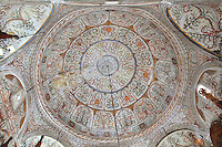 Decorative frescoes on the ceiling of the Et'hem Bey Mosque or Xhamia e Et'hem Beut, begun 1789 by Molla Bey and finished in 1823 by his son Haxhi Ethem Bey, great-grandson of Sulejman Pasha, Tirana, Albania. The frescoes decorating the mosque, unusual in Islamic art, depict trees, waterfalls, buildings and bridges and this ceiling fresco uses swirling vegetal designs. The mosque is listed as a Cultural Monument of Albania. Tirana was founded by the Ottomans in 1614 by Sulejman Bargjini and became the capital of Albania in 1920. Picture by Manuel Cohen