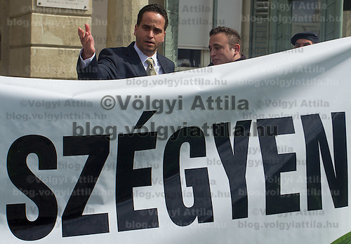 Norbert Kiss (C) spokesman of Pal Schmitt president of Hungary talks to protesters as the president covertly leaves his offlice in Budapest, Hungary on March 30, 2012. ATTILA VOLGYI