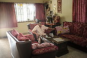 61 year old Lay Kee Tee, a former pig farmer and a  survivor of the Nipah virus ages television in his house in Bukit Pelandok in Nageri Sembilan, Malaysia on October 16th, 2016. <br /> In September 1998, a virus among pig farmers (associated with a high mortality rate) was first reported in the state of Perak in Malaysia. Dr. Chua investigated and discovered the virus and it was later named, Nipah Virus. The outbreak in Malaysia was controlled through the culling of &gt;1 million pigs.