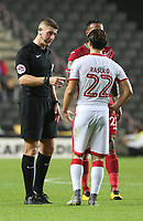 Referee Robert Jones speaks to Giorgio Rasulo of MK Dons during the Carabao Cup Second Round match between MK Dons and Swansea City at StadiumMK, Milton Keynes, England, UK. 22 August 2017