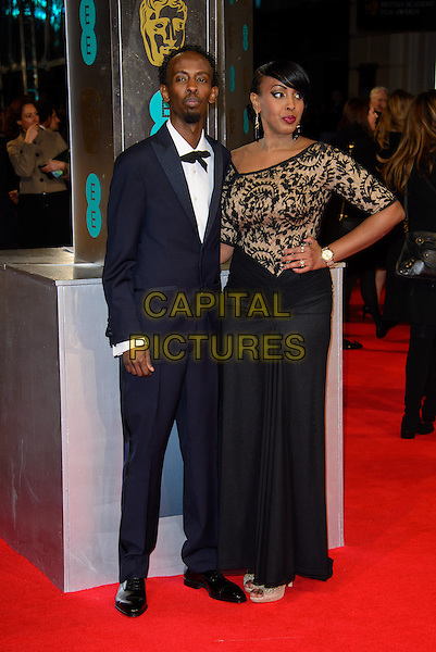 LONDON, ENGLAND - FEBRUARY 16: Barkhad Abdi &amp; Afifa Abdinasir Abdi attends EE British Academy Film Awards in 2014  at the Royal Opera House on February 16, 2014 in London, England.<br /> CAP/CJ<br /> &copy;Chris Joseph/Capital Pictures