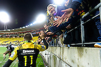 Jason Woodward Hi-Fives fans after the Super Rugby Final between The Hurricanes and The Lions at Westpac Stadium, Wellington, New Zealand on Saturday, 6 August 2016. Photo: Marco Keller / lintottphoto.co.nz