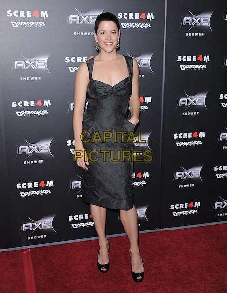 NEVE CAMPBELL .at the Weinstein World Premiere of 'Scream 4' held at The Grauman's Chinese Theatre in Hollywood, California, USa, April 11th 2011..full length hand in pocket sleeveless peep toe black shoes  grey gray  dress .CAP/RKE/DVS.©DVS/RockinExposures/Capital Pictures.