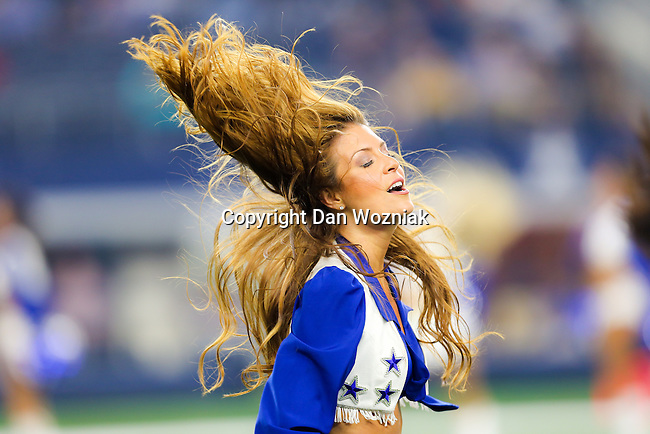 Dallas Cowboys Cheerleaders in action during the pre-season game between the Miami Dolphins and the Dallas Cowboys at the AT & T stadium in Arlington, Texas.