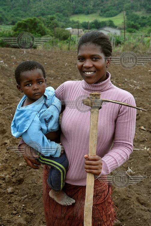 Ngeti Tsela with her child. She is a smallholding farmer in the Zombodze area near Manzini.