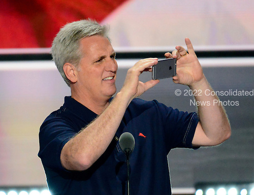 United States House Majority Leader Kevin McCarthy (Republican of California) takes a photo of the arena prior to the opening of the second day of the 2016 Republican National at the Quicken Loans Arena in Cleveland, Ohio on Tuesday, July 19, 2016.<br /> Credit: Ron Sachs / CNP<br /> (RESTRICTION: NO New York or New Jersey Newspapers or newspapers within a 75 mile radius of New York City)