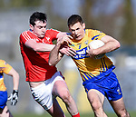Gary Brennan of Clare in action against Tommy Durnin of Louth during their national League game in Cusack Park. Photograph by John Kelly.