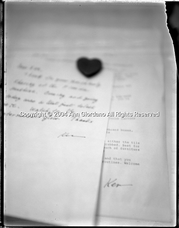 Letter with heart shaped magnet