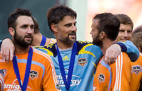Houston Dynamo goalkeeper (18) Pat Onstad celebrates the victory with midfielder (11) Brad Davis (R), and defender (5) Ryan Cochrane (L). The Houston Dynamo defeated the New England Revolution 2-1 in the finals of the MLS Cup at RFK Memorial Stadium in Washington, D. C., on November 18, 2007.