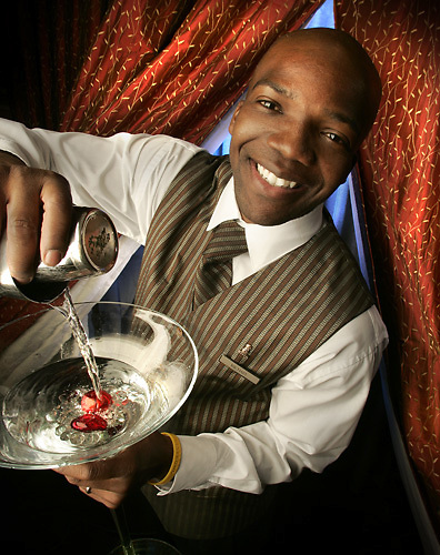 Slug: FD/Bartenders.Date: 12-18-2004.Photographer: Mark Finkenstaedt FTWP.Location:Ritz Carlton Georgetown & Blue Gin, Georgetown. Washington, DC.Caption: Michael Brown bartender at The Ritz Carlton, Georgetown and Blue Gin's Antonia Andrasi moonlight at personal bartenders for private parties.