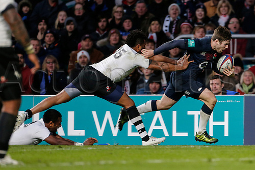 19.11.2016. Twickenham, London, England. Autumn International Rugby. England versus Fiji.  Metuisela Talebula of Fiji pushes Elliot Daly of England into touch to prevent the score.   Final score: England 58-15 Fiji.