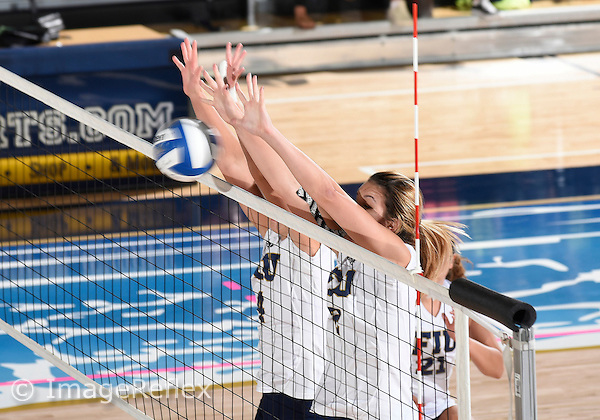 Florida International University women's volleyball middle blocker Gloria Levorin (4) and outside hitter Lucia Castro (2) play against  the University of Central Florida which won the match 3-0 on September 17, 2015 at Miami, Florida.