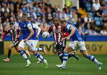 Leon Clarke of Sheffield Utd forces his way through Joost van Aken and Tom Lees of Sheffield Wednesday to score during the Championship match at the Hillsborough Stadium, Sheffield. Picture date 24th September 2017. Picture credit should read: Simon Bellis/Sportimage