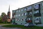 POLAND, Juchowo, church and block building from communist time / POLEN, Juchow, katholische Kirche und Wohnblock aus der kommunistischen Zeit