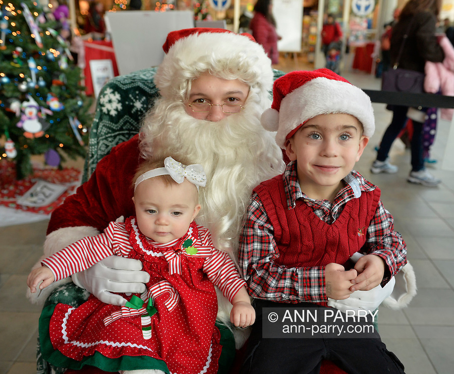 Garden City, New York, USA. November 30, 2013. SUMMER, a 7-month-old girl, and her big brother SAWYER, 4, of Long Beach, visit with Santa Claus at the Winter holiday event Festival of Trees, held at Cradle of Aviation Museum during Thanksgiving weekend, with proceeds benefiting United Cerebral Palsy Association of Nassau County, Long Island.