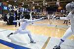 12 February 2017: UNC's Justine de Grasse (left) attacks Northwestern's Aahana Chatterjee (right) during their Epee match. The University of North Carolina Tar Heels played the Northwestern University Wildcats at Card Gym in Durham, North Carolina in a 2017 College Women's Fencing match. UNC won the dual match 15-12 overall, 5-4 Foil, 5-4 Epee, and 5-4 Saber.