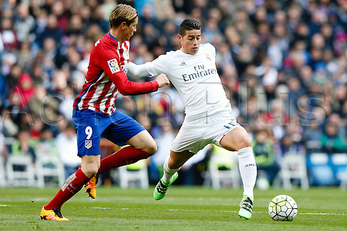 27.02.2016. Madrid, Spain.  Fernando Torres (9) Atletico de Madrid and James Rodriguez (10) Real Madrid during La Liga match between Real Madrid and Atletico de Madrid at the Santiago Bernabeu stadium in Madrid, Spain