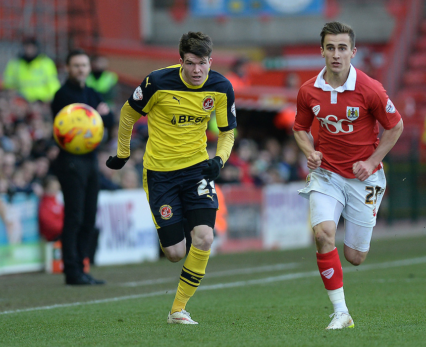 Fleetwood Town's Liam Mcslinfrn vies for possession with Bristol City's Joe Bryan<br /> <br /> Photographer Ashley Crowden/CameraSport<br /> <br /> Football - The Football League Sky Bet League One - Bristol City v Fleetwood Town - Sunday 1st February 2015 - Ashton Gate - Bristol<br /> <br /> &copy; CameraSport - 43 Linden Ave. Countesthorpe. Leicester. England. LE8 5PG - Tel: +44 (0) 116 277 4147 - admin@camerasport.com - www.camerasport.com
