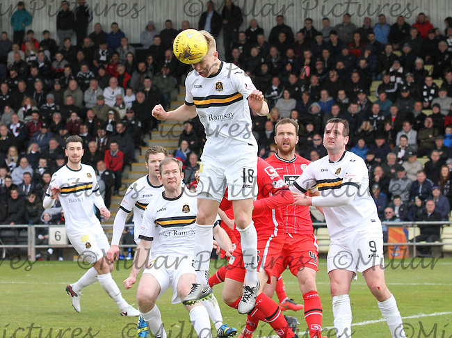 Jamie Lindsay heads clear in the Dumbarton v St Mirren Scottish Professional Football League Ladbrokes Championship match played at The Cheaper Insurance Direct Stadium, Dumbarton on 23.4.16.