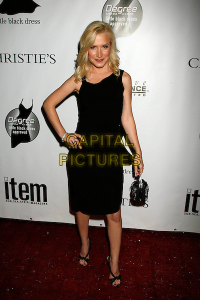 ANGELA KINSEY.Arrivals - Little Black Dress celebrates its Fifth Anniversary at Fleur de Lys, Bel Air, California, USA, .18 November 2006..full length black dress hand on hip.CAP/ADM/RE.©Russ Elliot/AdMedia/Capital Pictures.