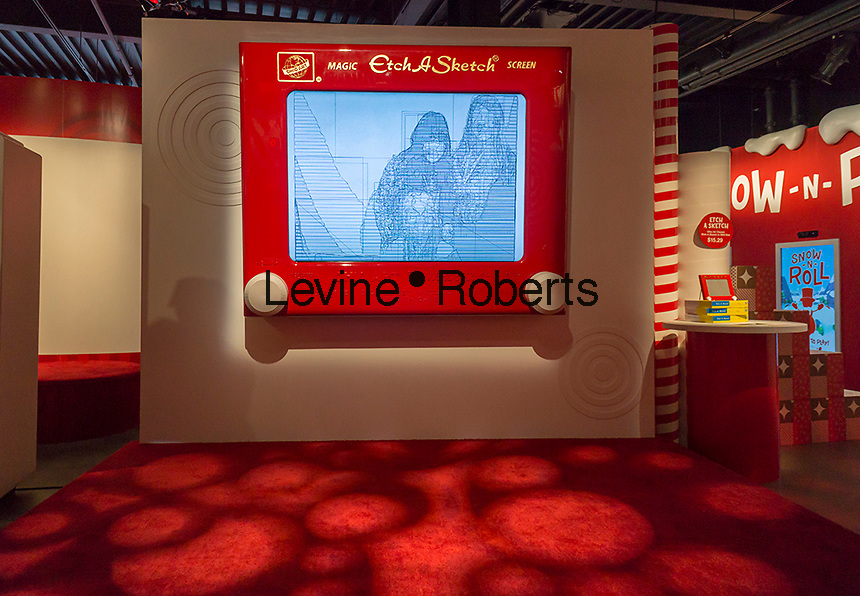 """A giant Etch-A-Sketch display in the Target """"Wonderland!"""" pop-up store in the Meatpacking District in New York on its grand opening day, Wednesday, December 9, 2015. According to Target the store combines physical and digital shopping using medallions given to visitors with an embedded RFID chip. Tapping the chip to an antenna near the product lets you order it. The store is an experiment in technology replacing shopping carts with chips.  (© Richard B. Levine)"""