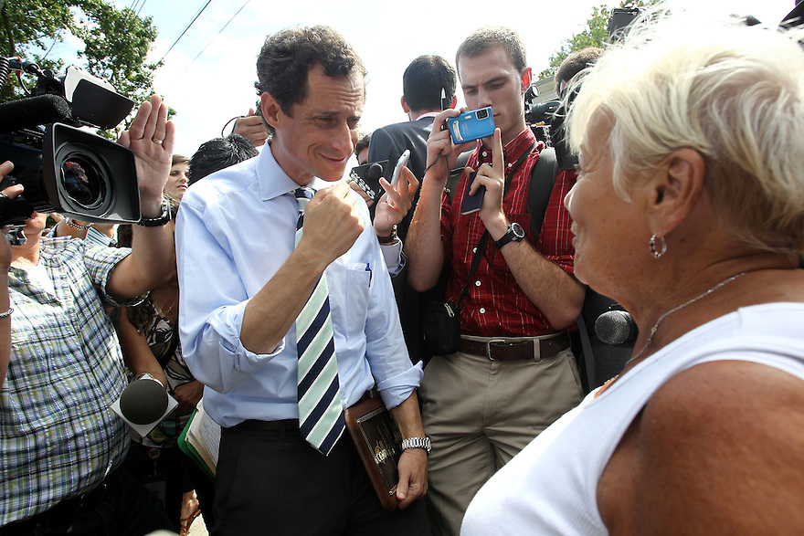Anthony Weiner left, speaks to a Staten Island resident after touring a damaged home from Super Storm Sandy on Friday, July 25, 2013 in Staten Island, New York. (AP Photo/ Donald Traill)